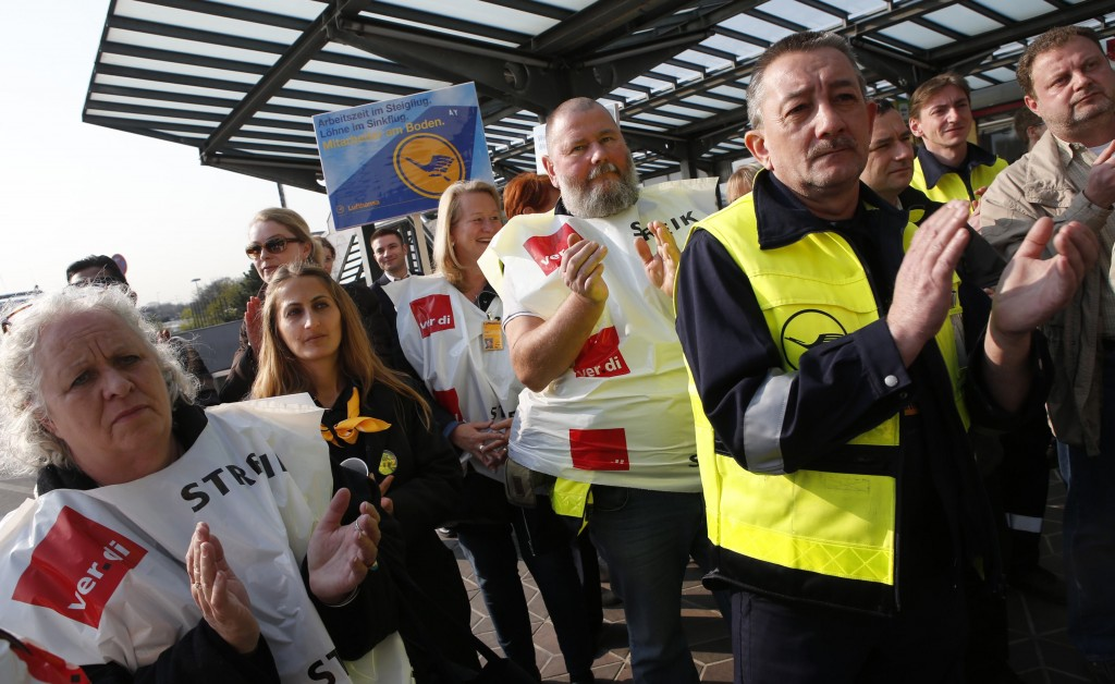 Union members attend a rally as they take part in a warning strike of German air carrier Lufthansa's ground personnel at Tegel airport in Berlin, April 22, 2013. Lufthansa passengers faced chaos on Monday after the airline cancelled virtually all of its flights in Germany due to a strike by staff over pay. Overall, around 1,700 flights will be cancelled, Lufthansa said. REUTERS/Fabrizio Bensch (GERMANY - Tags: TRANSPORT BUSINESS EMPLOYMENT CIVIL UNREST)