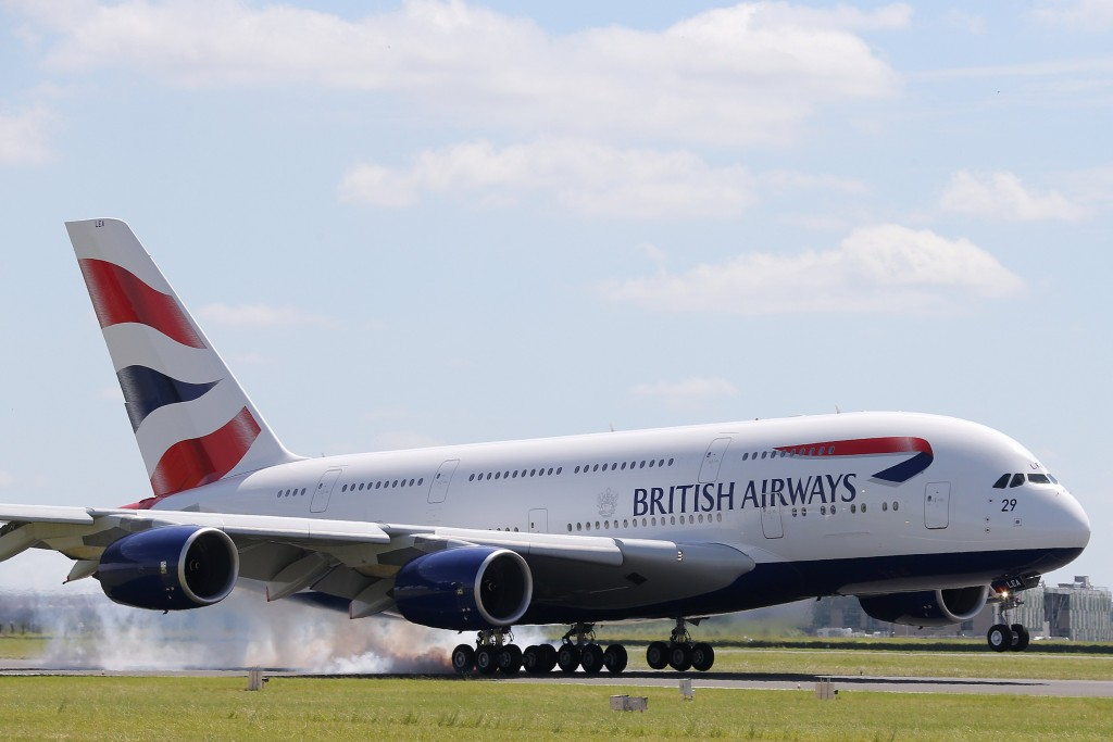 A British Airways Airbus A380 lands at the Le Bourget airport near Paris, one day before the start of the 50th Paris Air Show, June 16, 2013. The Paris Air Show runs from June 17 to 23. REUTERS/Pascal Rossignol (FRANCE - Tags: BUSINESS TRANSPORT)