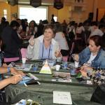 Adriana Penha, de Curaçao, com agentes na rodada de negócios
