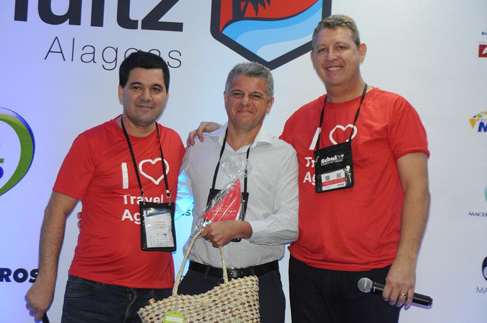 Luciano Bonfim e Aroldo Schultz, da Schultz, com Marcelo Freitas, da American Life