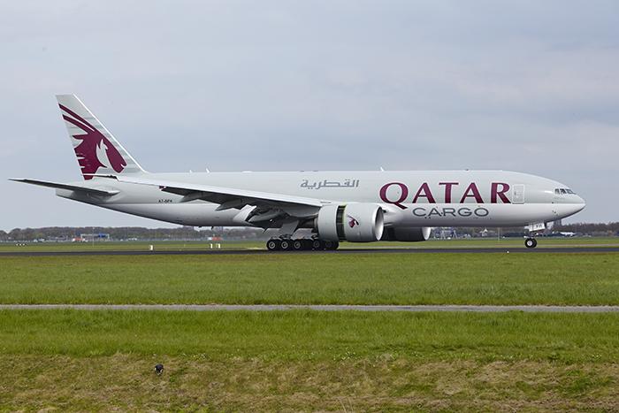 Amsterdam, The Netherlands - May 4, 2015: A Boeing 777-FDZ of Qatar Airways Cargo lands at Amsterdam Airport Schiphol (The Netherlands, AMS) on May 4, 2015. The name of the runway is Polderbaan.