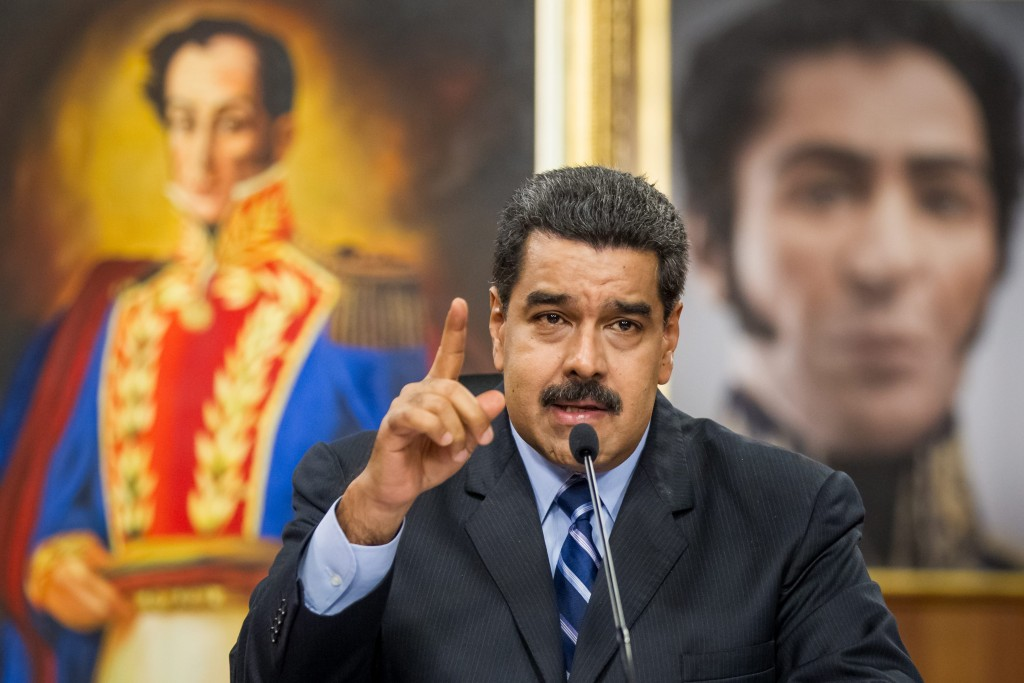 epa05312902 Venezuelan President Nicolas Maduro speaks during a press conference at the Miraflores Presidential Palace in Caracas, Venezuela, 17 May 2016. Maduro denounced the violation of Venezuelan airspace by US airplanes that flew over illegally two times in the last week. EPA/MIGUEL GUTIERREZ