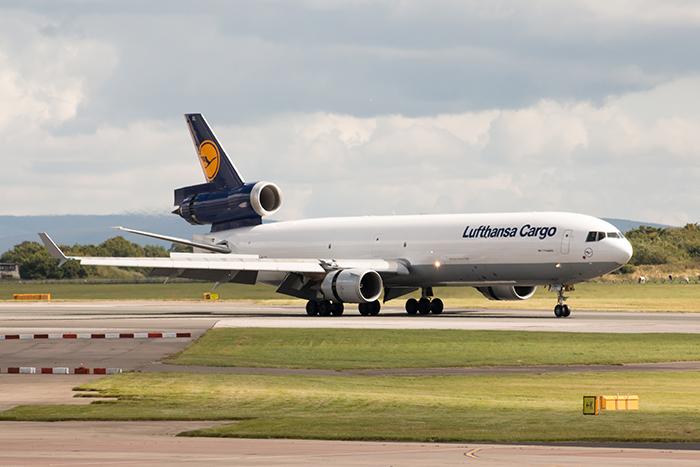 Manchester, United Kingdom - August 27, 2015: Lufthansa Cargo MD-11 freight plane landing to Manchester International Airport runway.