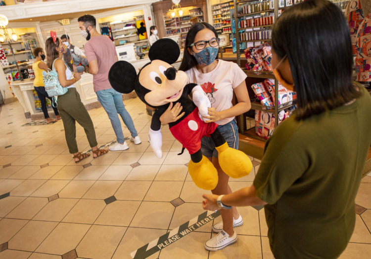 Guest capacity in retail shops at Walt Disney World Resort theme parks in Lake Buena Vista, Fla., will be limited when the parks begin their phased reopening July 11, 2020. Ground markings support physical distancing, and physical barriers are in place in certain locations. (David Roark, photographer)