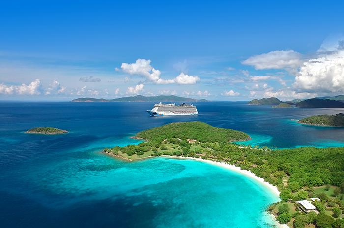 aerial view of Caneel Bay and Hawksnest Bay, St.John, US Virgin Islands with Jost Van Dyke and Tortola, British Virgin Islands in the background