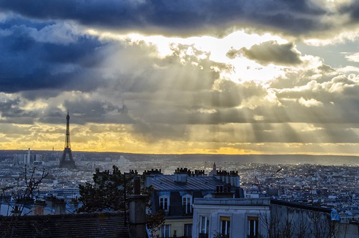 A breathtaking shot of a sunrise over the beautiful city of Paris