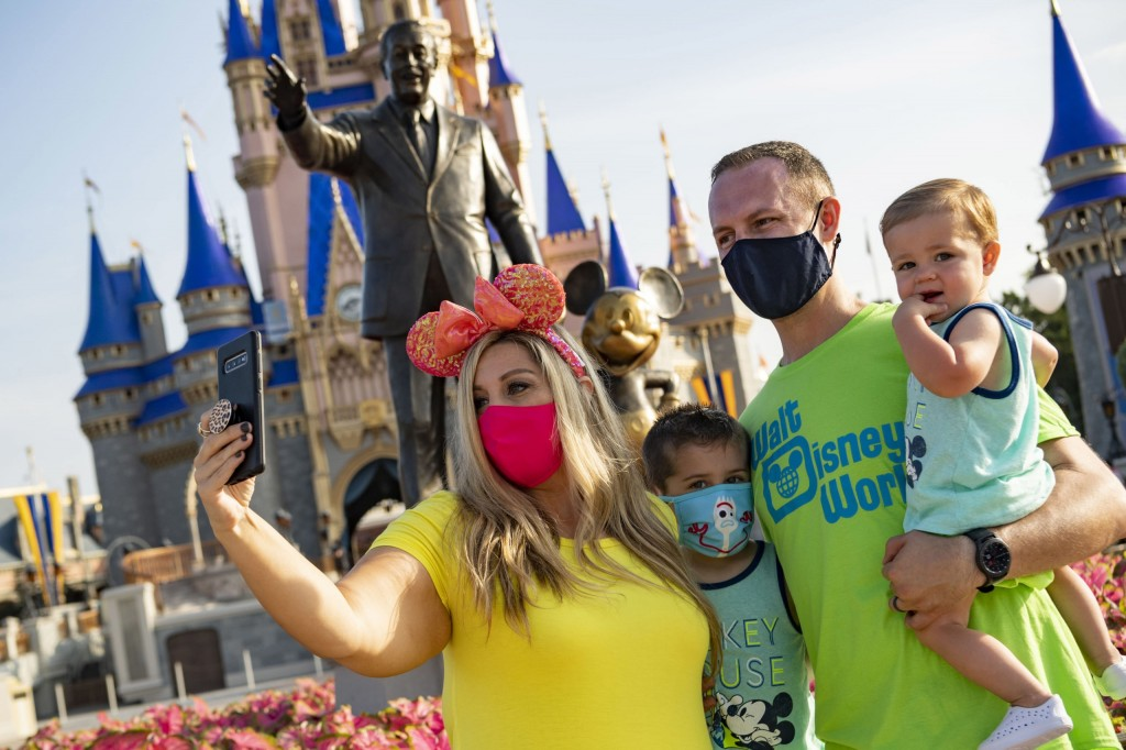 Guests stop to take a selfie at Magic Kingdom Park, July 11, 2020, at Walt Disney World Resort in Lake Buena Vista, Fla., on the first day of the theme park's phased reopening. (Matt Stroshane, Photographer)