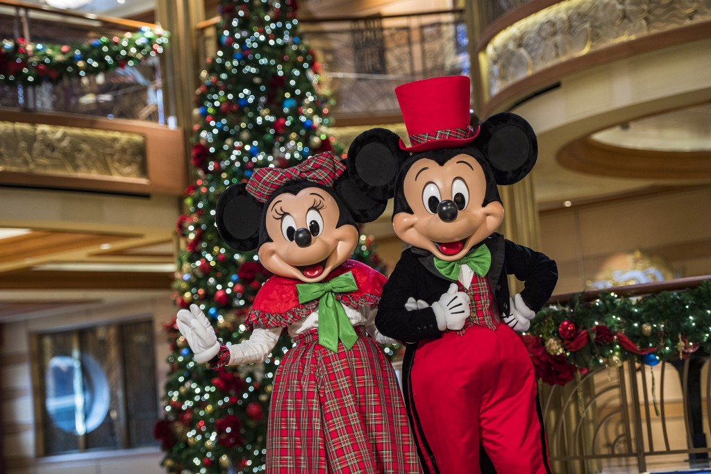"""In the spirit of holiday cheer, Disney Cruise Line adds sparkle to each ship during Very Merrytime Cruises, with Disney characters dressed in festive attire, special stem-to-stern holiday events, traditional """"turkey day"""" fanfare, Christmas feasts, """"snow flurries"""" and New Year's Eve galas. (Matt Stroshane, photographer)"""