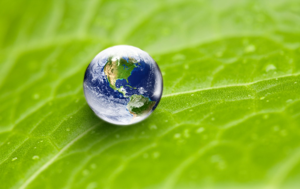Ecology - Enviornmental conservation concept: World globe as waterdrop with